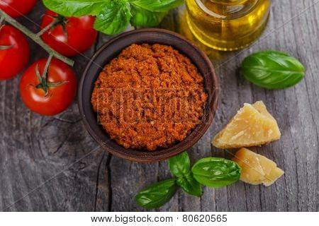 pesto sauce red rosso on a wooden surface