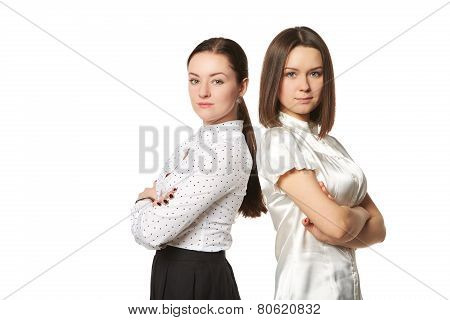 two business women in white shirts