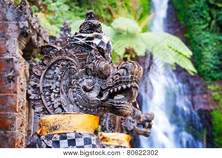 Hindu Dragon Statues Detail With Waterfall Gitgit