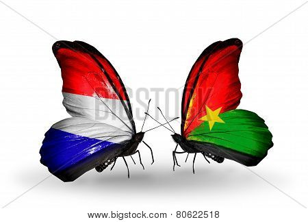 Two Butterflies With Flags On Wings As Symbol Of Relations Holland And Burkina Faso