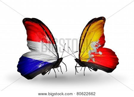 Two Butterflies With Flags On Wings As Symbol Of Relations Holland And Bhutan