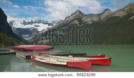 Canadian Landscape In Lake Louise With Canoes. Alberta. Canada