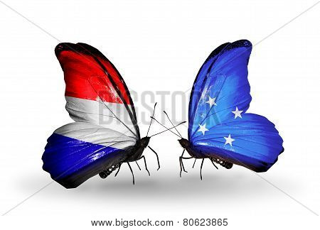 Two Butterflies With Flags On Wings As Symbol Of Relations Holland And Micronesia