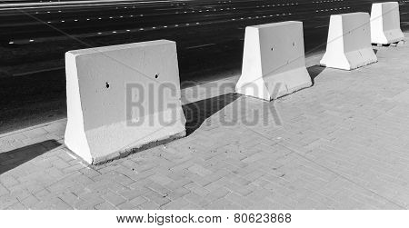 Road Barrier. White Concrete Blocks Stand On Roadside