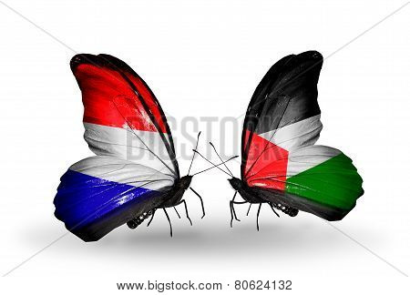 Two Butterflies With Flags On Wings As Symbol Of Relations Holland And Palestine