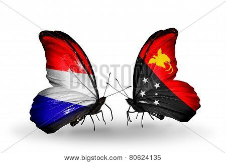 Two Butterflies With Flags On Wings As Symbol Of Relations Holland And Papua New Guinea