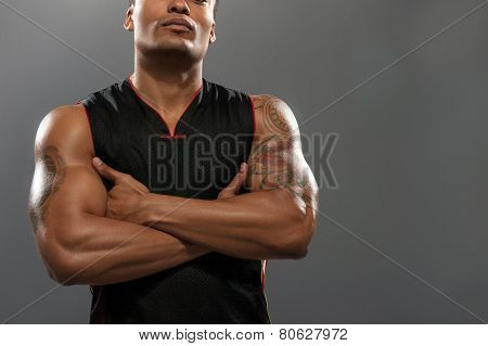 Young handsome African basketball player with his hands crossed