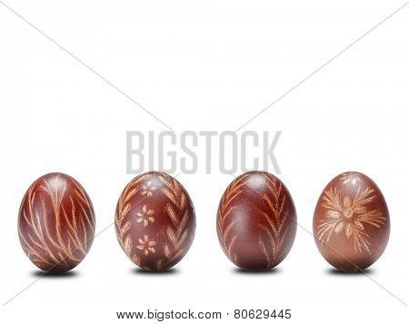 Four brown scratched easter eggs on white background