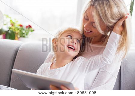 Mother and daughter using tablet computer together