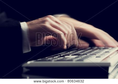 Business Man Typing On A Computer Keyboard