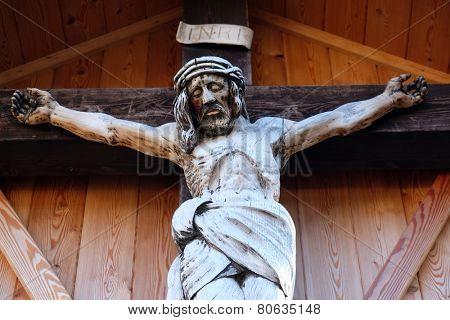 ST. GILGEN, AUSTRIA - DECEMBER 14: Crucifixion, Cemetery in St. Gilgen on Wolfgang See lake, Austria on December 14, 2014.