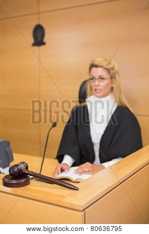 Stern judge speaking to the court in the court room