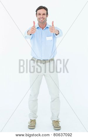 Portrait of confident supervisor showing thumbs up over white background