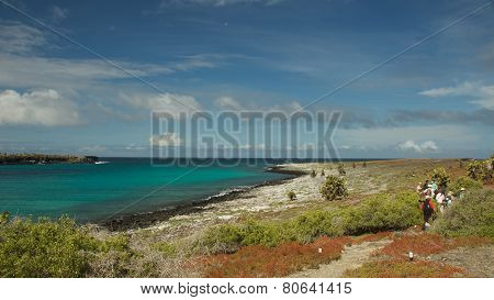 Galapagos Islands, Ecuador - July 2014: Travelers Hiking in South Plaza Island