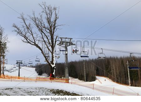 Ski chair-lift with skiers.