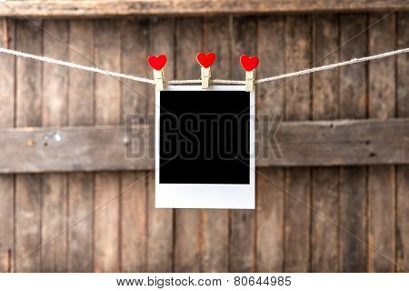 Old Picture Frame Hanging On The Clothesline