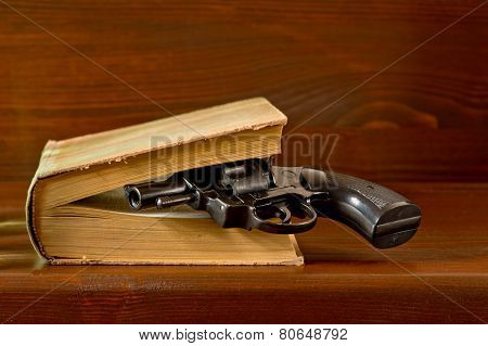 Book With Handgun