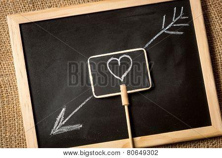 Photo Of Heart With Arrow Drawn By Chalk On Blackboard