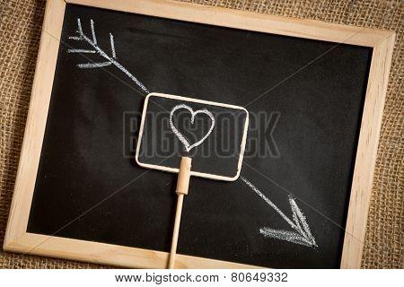 Photo Of Arrow Going Through Heart Drawn On Blackboard