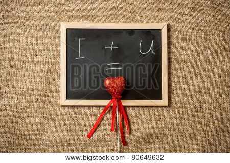 Equation Of Love Written On Blackboard With Red Heart