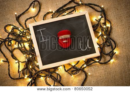 Marriage Proposal Question On Blackboard With Golden Ring