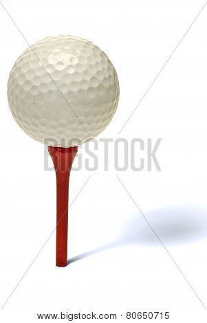 Golf Ball On Red Tee With Shadow