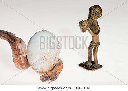 Flutist Sculpture And Egg