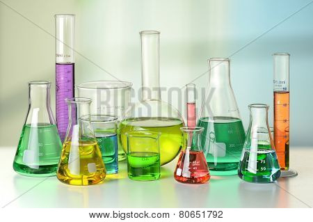 Laboratory glassware on white table and window in background - With Clipping Path on glassware