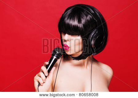 Woman singing. Closeup portrait of beautiful girl with pink lips. Karaoke
