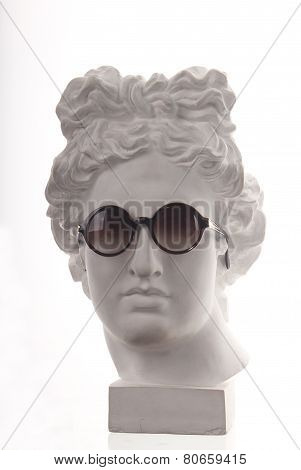 Plaster bust o in glasses