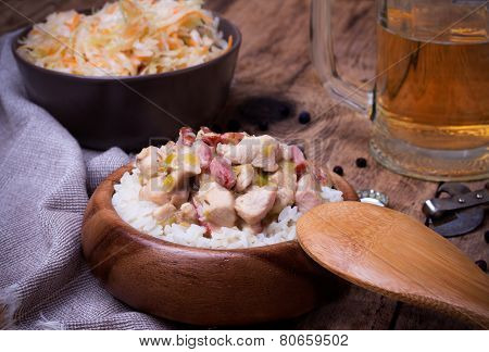 Chicken Stew With Rice, Sauerkraut And Beer On Rustic Wooden Desk