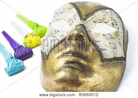 Venetian Mask And Blower On White Background