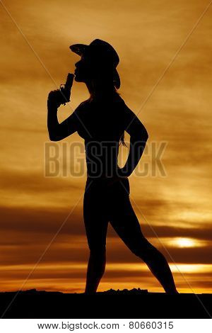 Silhouette Of Woman Cowboy Hat With Gun Blow
