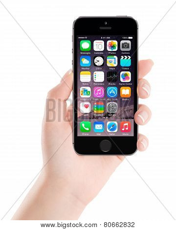 Apple Space Gray Iphone 5S Displaying Ios 8 In Female Hand, Designed By Apple Inc