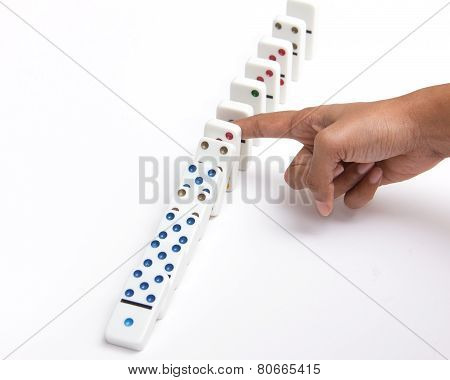 Person Stopping The Domino Effect