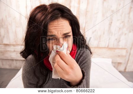 Frustrated woman blowing her nose