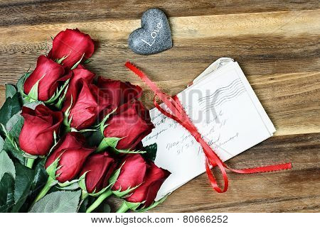 Dozen Roses With Old Letters