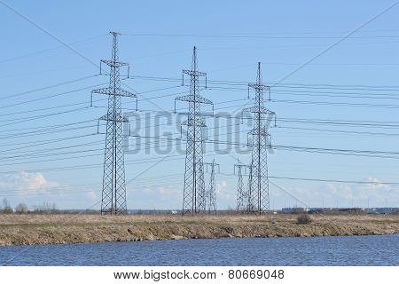Spring Landscape With Electricity Pylons.