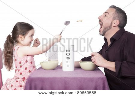 Father And Daughter Eating Muesli