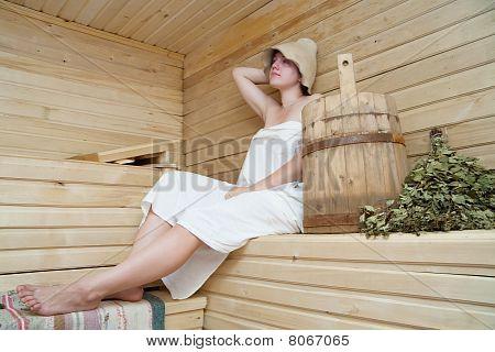 Young Woman Take A Steam Bath At Sauna