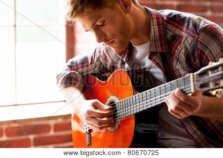 Handsome Man Playing Guitar.