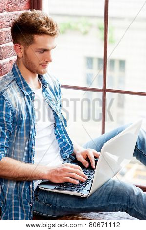 Man Surfing The Net.