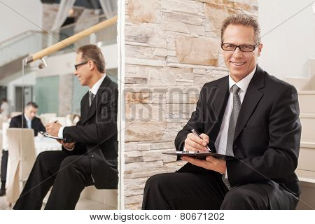 Businessman Making Notes.