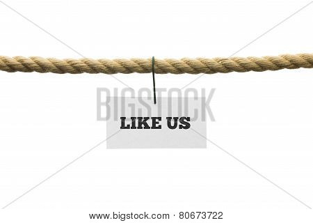 White Card With Like Us Text Hanging By Wire From A Rope