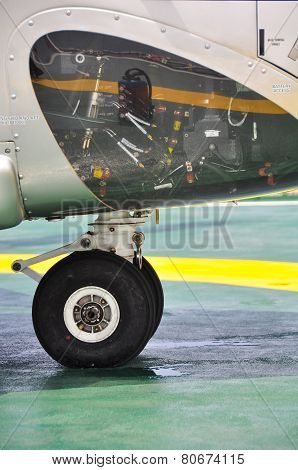 Wheel of airplane or helicopter parking on parking area. support of airplane.