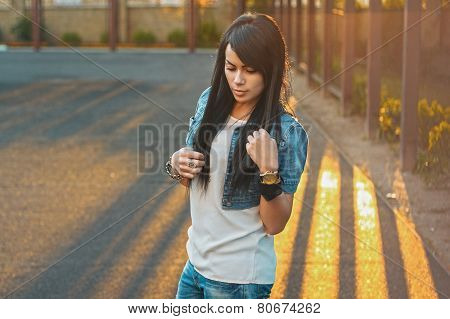 Beautiful Girl In A Denim Jacket In The Sunlight Sunset.