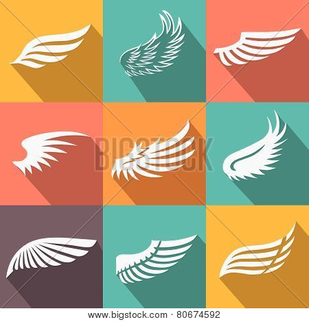 Abstract feather angel or bird wings icons set isolated vector illustration