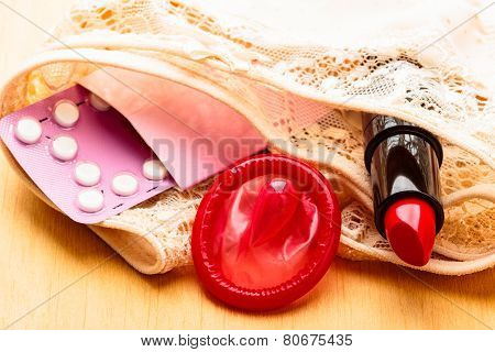 Pills Condom And Lipstick On Lace Lingerie