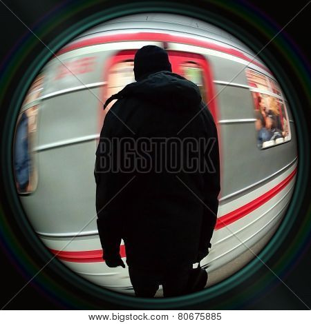 Man Waiting For Subway In Objective Lens