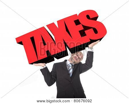 Businessman In Stress Carrying Heavy Taxes 3D Text Word On His Arms As A Painful Burden In Tax Payin